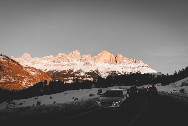 Car driving through the Dolomites mountain region