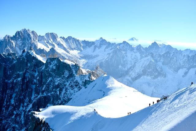 Skiers on a mountain ridge in Chamonix