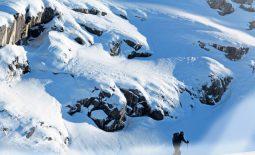 A solo man skier ski touring through the mountains in Chamonix