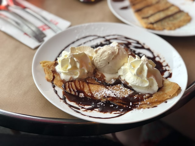 Think crepe covered in chocolate sauce, ice cream and cream.