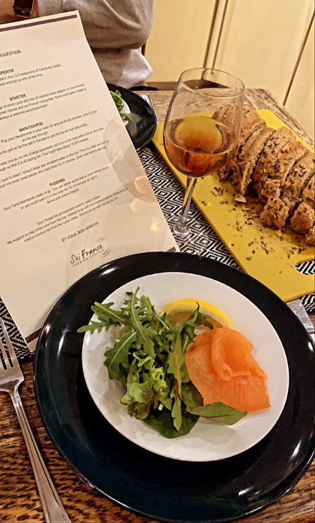 Plate of salmon and salad on a dining table