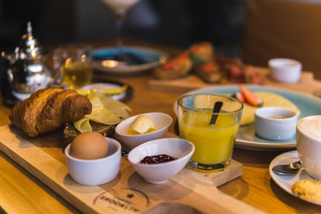 A selection of breakfast food on a wooden table